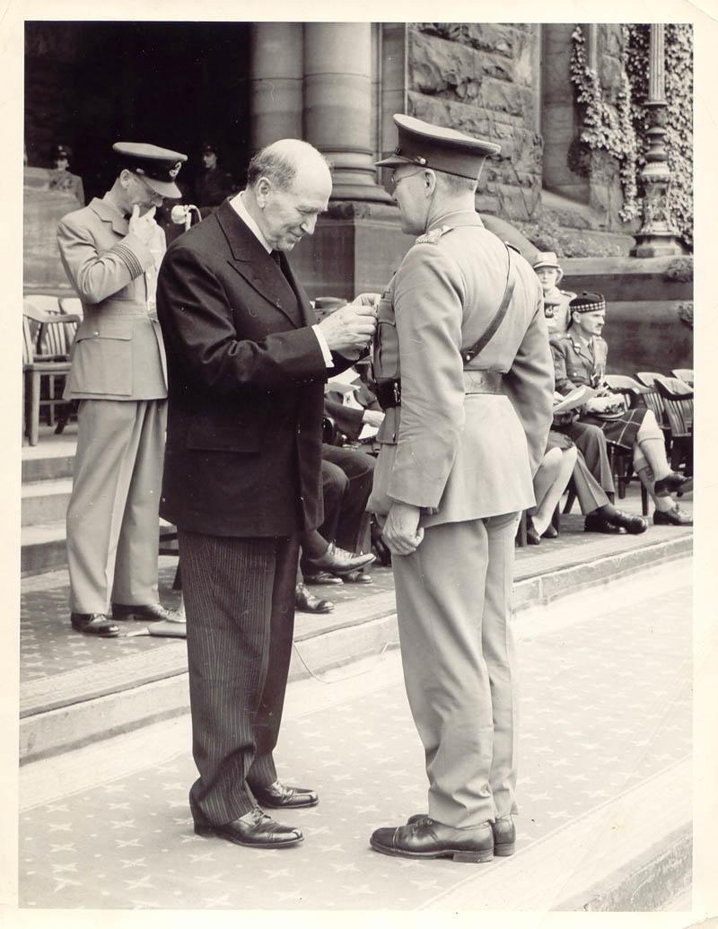 Lieutenant Colonel James W. Ross receiving his O.B.E.